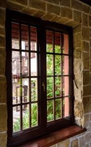 closed wooden plastic vinyl window in old interior